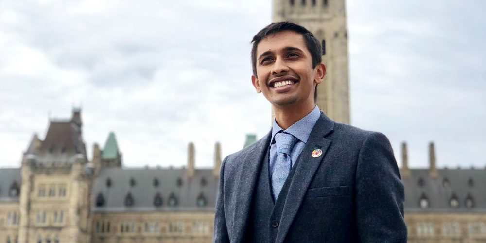 Aditya stands outside Parliament Hill meetings, to implement Canada's Feminist International Assistance Policy internationally.